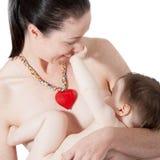 Amamentação da mãe Foto de Stock