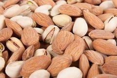 Amandes et fond 5 de pistaches Photo libre de droits