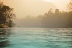 Amanecer en el río Foto de archivo