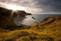Amanecer en la costa jurásica Fotos de archivo libres de regalías