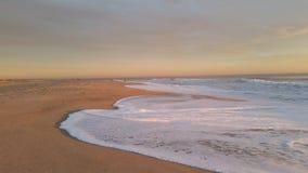 Amanecer en la orilla Fotografía de archivo libre de regalías