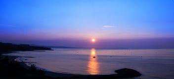 Amanecer en Mui Ne Beach Foto de archivo libre de regalías