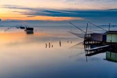 Amanecer Ferrara Emilia Romagna Italia de la laguna de Comacchio Imagen de archivo libre de regalías