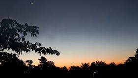 Amanecer y la luna fotografía de archivo libre de regalías