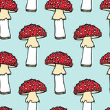 Amanita seamless pattern. Vector seamless pattern with hand drawn poisonous fungus Amanita. Ink drawing, graphic style. Beautiful design elements Royalty Free Stock Images