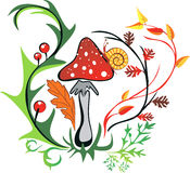Amanita with snail surrounded by colorful leaves Stock Photo