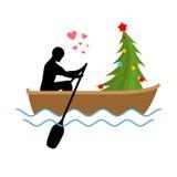 Amante do Natal Passeio da árvore do homem e de Natal no barco Amantes de Foto de Stock