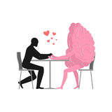 Amante en café El hombre y el perrito caliente se está sentando en la tabla Fotografía de archivo