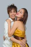 Amantes con clase adolescentes en el partido Imagen de archivo