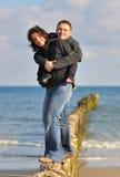Amantes en la playa Foto de archivo