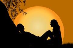 Amantes en la puesta del sol ilustración del vector