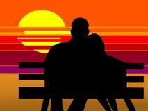 Amantes en la puesta del sol Fotografía de archivo libre de regalías