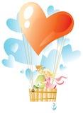 Amantes individuo y muchacha por un baloon Foto de archivo