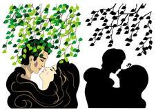 Amantes que beijam sob a árvore Imagem de Stock