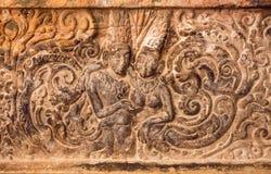 Amants, deux personnes historiques - homme et femme - sur le soulagement découpé de mur fait dedans vers le 7ème siècle Temple hi Photographie stock libre de droits