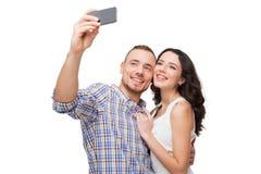 Amants faisant le selfie Ils sourient Photos stock