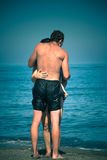 Amants sur la plage Photographie stock