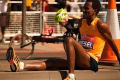 AMANUEL MESEL. London Marathon AMANUEL MESEL Sitting Pain Royalty Free Stock Photography