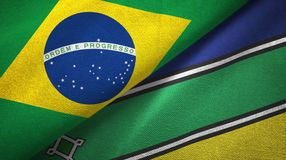 Amapa state and Brazil flags textile cloth, fabric texture. Amapa state and Brazil folded flags together royalty free illustration