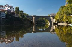 Amarante. The historical city of Amarante (Portugal) with its old roman style bridge (Ponte de Sao Goncalo) both reflected in the river stock image