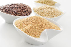 Amaranth, brown flax, quinoa and buckwheat seeds Royalty Free Stock Photos