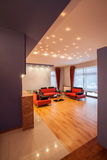 Amaranth house - modern living room. With red and black couch Royalty Free Stock Photo