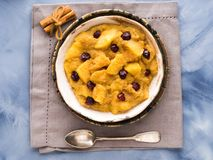 Amaranth porridge with apples and cinnamon. Amaranth porridge with apples, cinnamon, turmeric and dried fruit. Gluten free breakfast meal Royalty Free Stock Image