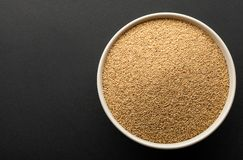 Amaranth seeds in ceramic bowl isolated on dark background Stock Photography