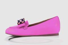 Amaranth shoes. Isolated over white background Royalty Free Stock Photo