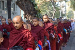 AMARAPURA, MYANMAR - JAN 15 : Buddhist novices wal Stock Photography