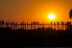 AMARAPURA, MYANMAR - NOVEMBER: Unidentified people walk on U Bein bridge at sunset on November,  in Amarapura, Myanmar. U Stock Photo