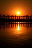 AMARAPURA, MYANMAR - NOVEMBER: Unidentified people walk on U Bein bridge at sunset on November,  in Amarapura, Myanmar. U Royalty Free Stock Photography