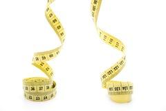 Amarele a fita de medição rolada Fotografia de Stock