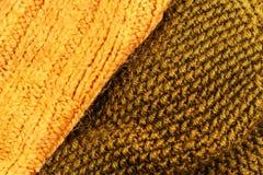 Amarele o fim feito malha do fundo da textura da tela de lãs acima W dourado Fotografia de Stock Royalty Free