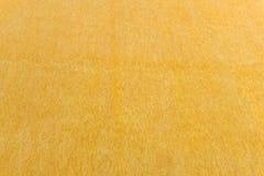 Amarele o fundo colorido da textura da parede, mármore pelo emplastro Venetian fotografia de stock