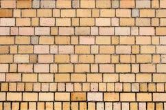 Amarele o fundo da parede de tijolo Imagem de Stock