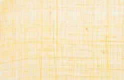 Amarele o fundo de matéria têxtil Foto de Stock Royalty Free
