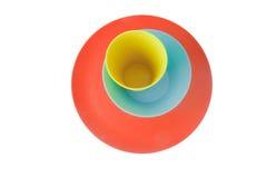 Amarelo-alaranjado-azul ajustado do dishware triplo Fotografia de Stock Royalty Free