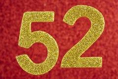 Amarelo do número cinquenta e dois sobre um fundo vermelho anniversary Hori Fotografia de Stock