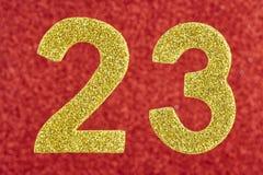 Amarelo do número vinte e três sobre um fundo vermelho anniversary Imagens de Stock Royalty Free