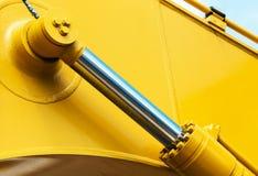 Amarelo do trator da hidráulica fotografia de stock