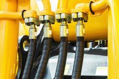 Amarelo do trator da hidráulica imagem de stock