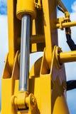 Amarelo do trator da hidráulica fotografia de stock royalty free