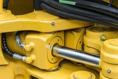 Amarelo do trator da hidráulica imagens de stock royalty free