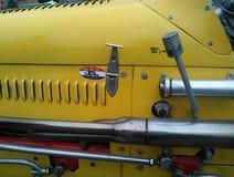 Amarelo do vintage do carro de corridas Fotografia de Stock