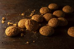Amaretti bisquits on wooden table stock photography