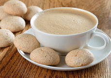 Amaretti cookies with a cappuccino Royalty Free Stock Image