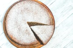 Amaretti pumpkin pie. On the wooden background Royalty Free Stock Images