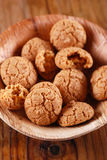 Amaretti in the wooden bowl Royalty Free Stock Images
