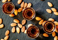 Amaretto almond liqueur with a dark background, top view royalty free stock photography